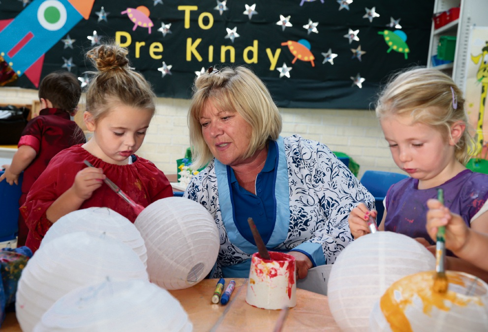 Education assistant Caroline Blake with Gracie Wood (3) and Emily Bagshaw (3). Picture: Martin Kennealey d468723