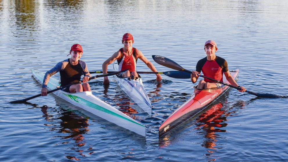 Club members Tim Hyde (left) (13) of Applecross, Tom Green (15) of Wilson (centre) and Australian Olympic team member Luke Egger (14) in their K1 canoes at Shelley. Picture: Emma Geary