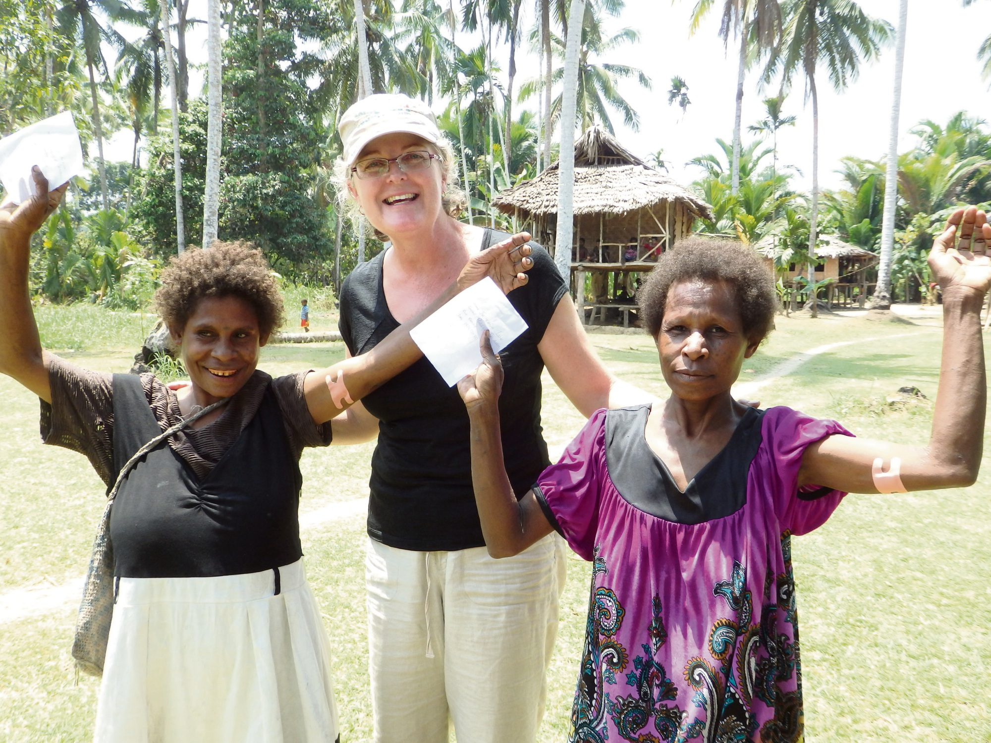 Living Child founder Sara David with two PNG women who received a contraceptive implant.