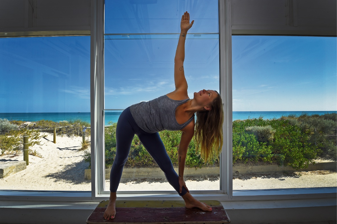 Sofi Eriksen practises yoga at Coast Port Beach. Picture: Jon Hewson        www.communitypix.com.au   d468679