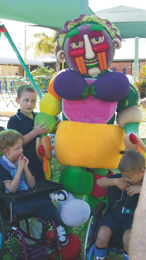 Malibu School students Theo Legg, Bailey Barber and Finley Lyell with Vegie Man.