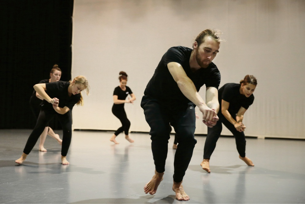 Dancers Mitchell Harvey and Zoe Wozniak (right) from CO3 and students.