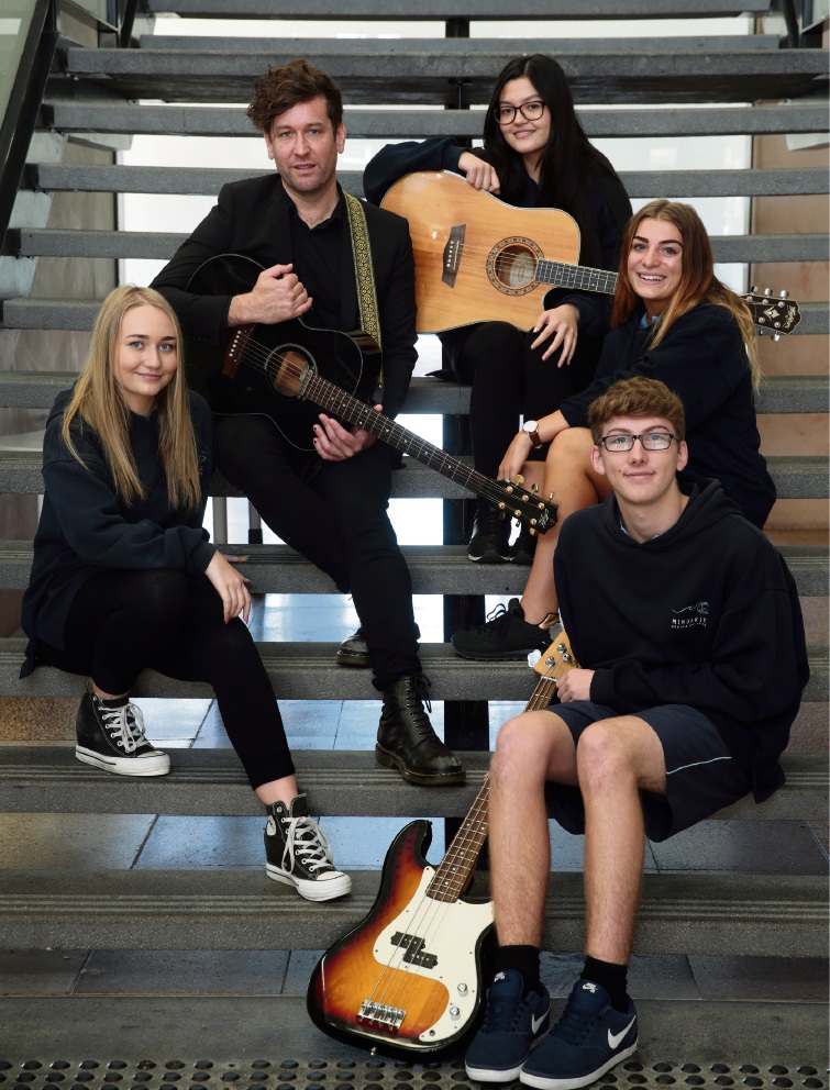 Eskimo Joe lead singer Kav Temperley with Tear 12 students Indiah Parker,Tinsey Jones,Willow Morton and Callum Welch. Picture: Martin Kennealey