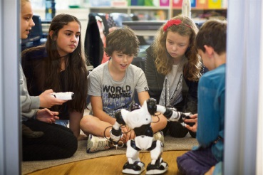 Kate Botica, Aliyah Saleem, Angus Troon and Margarida Shrubsall try out new robots and android inventions in Quintilian's weekly Robotics Club.