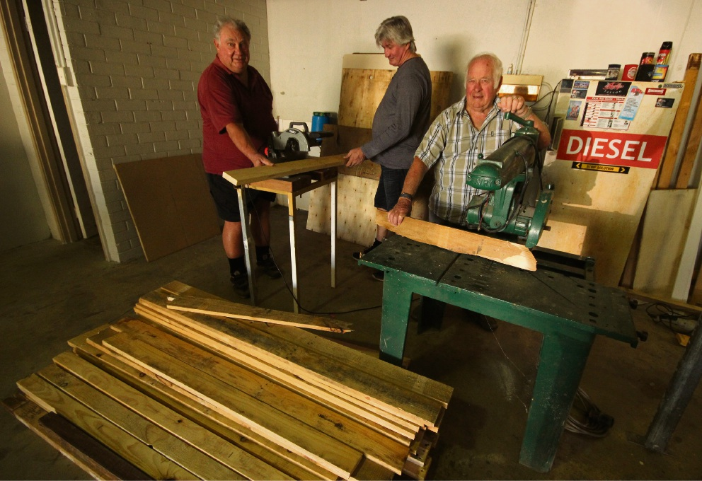 Lou Dorsa, Mark Brljevic and Malcolm Gow in Yanchep Community Men's Shed's temporary home.