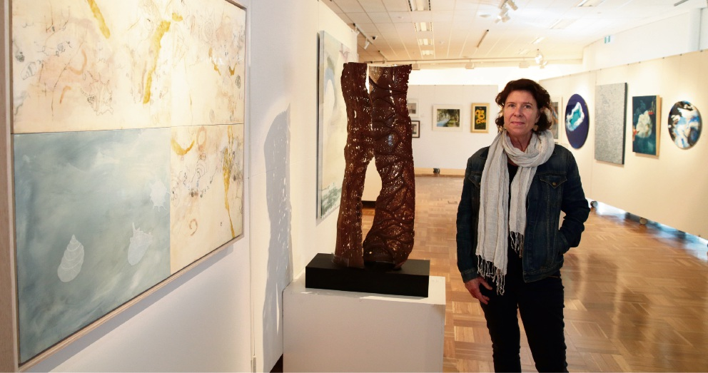 Artist Jennifer Sadler, of Carramar, with her work Tide Marks (far left).  Picture: Martin Kennealey        d468858