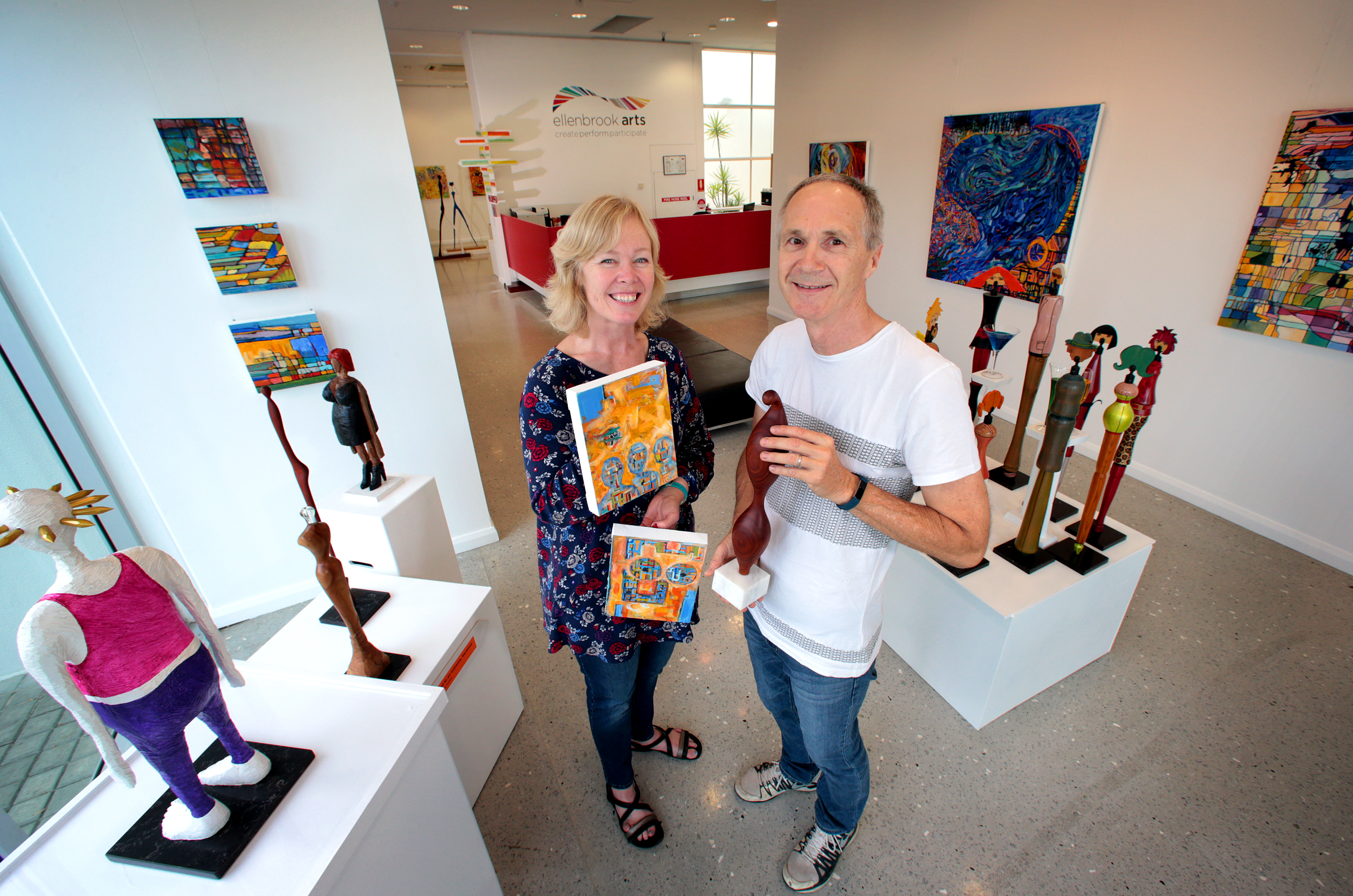 Mixed media artist Carmel Sayer, of Mandurah, and chainsaw artist and sculptor Ernst Schneider, of Hillarys. Picture: David Baylis d468716