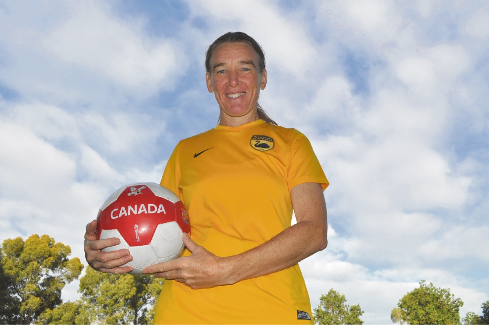 Bull Creek resident Penny Hoath with the soccer ball she was presented after being named MVP of the Black Swans first match at the World Masters Games.