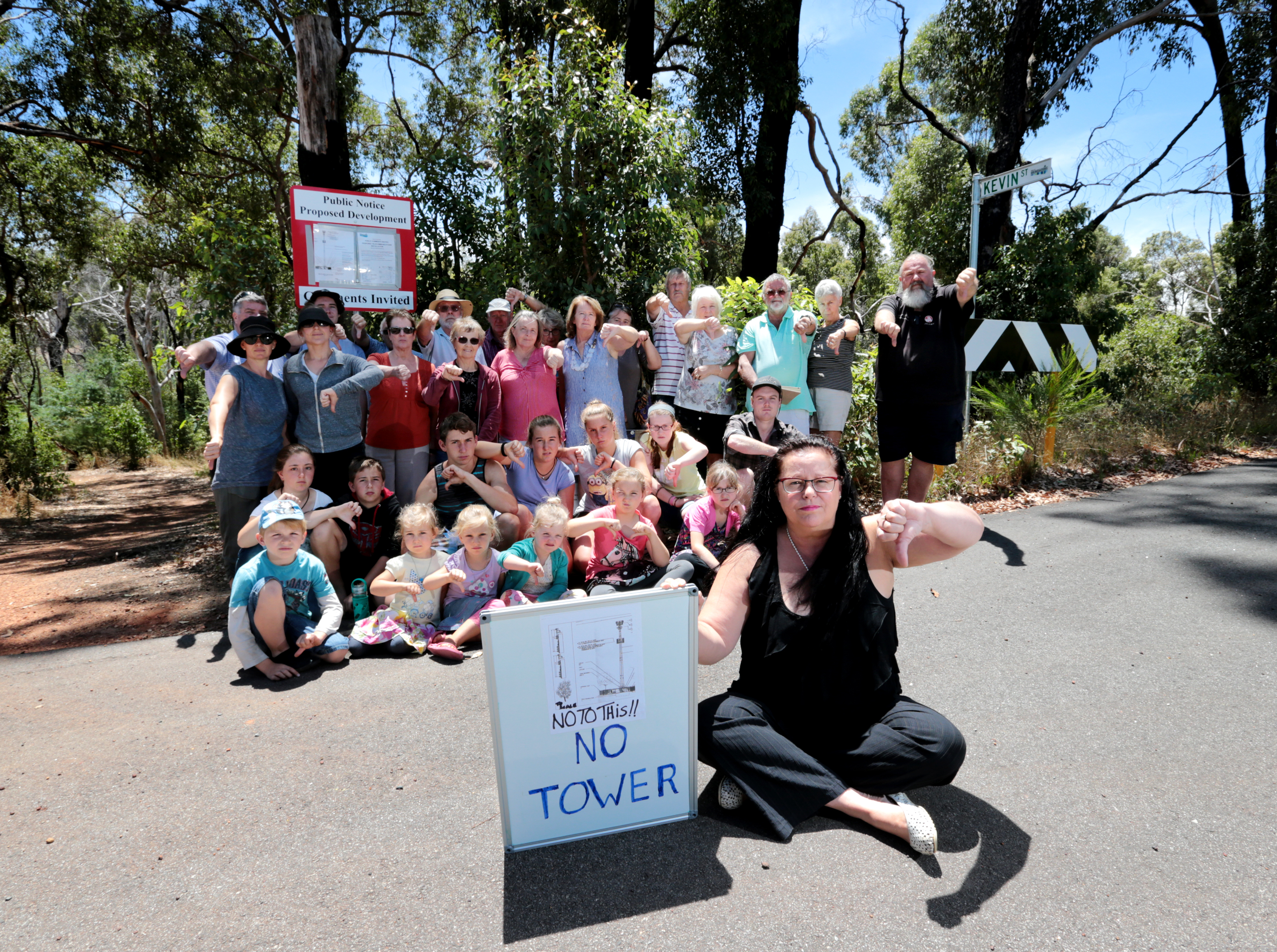 Rosie Zilioli and other concerned residents near the location of the NBN tower in Stoneville which was approved by councillors this week. Picture: David Baylis d465124