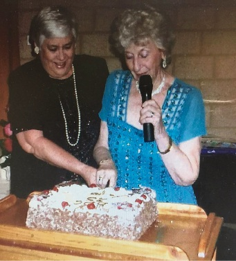 Elisabeth Dick and Doris Somerville cut the 25th anniversary cake.