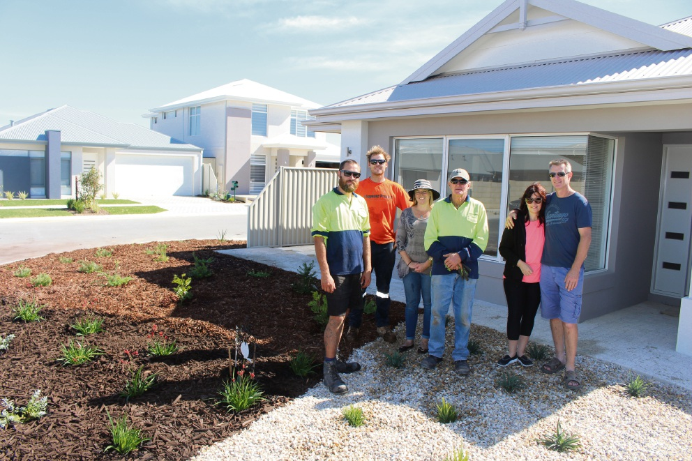 The Forever Project team members Alexei McKay, Simon Pawley, Lisa Passmore and Trevor Brown with residents Rita Radei and Darren Yates after the garden makeover.
