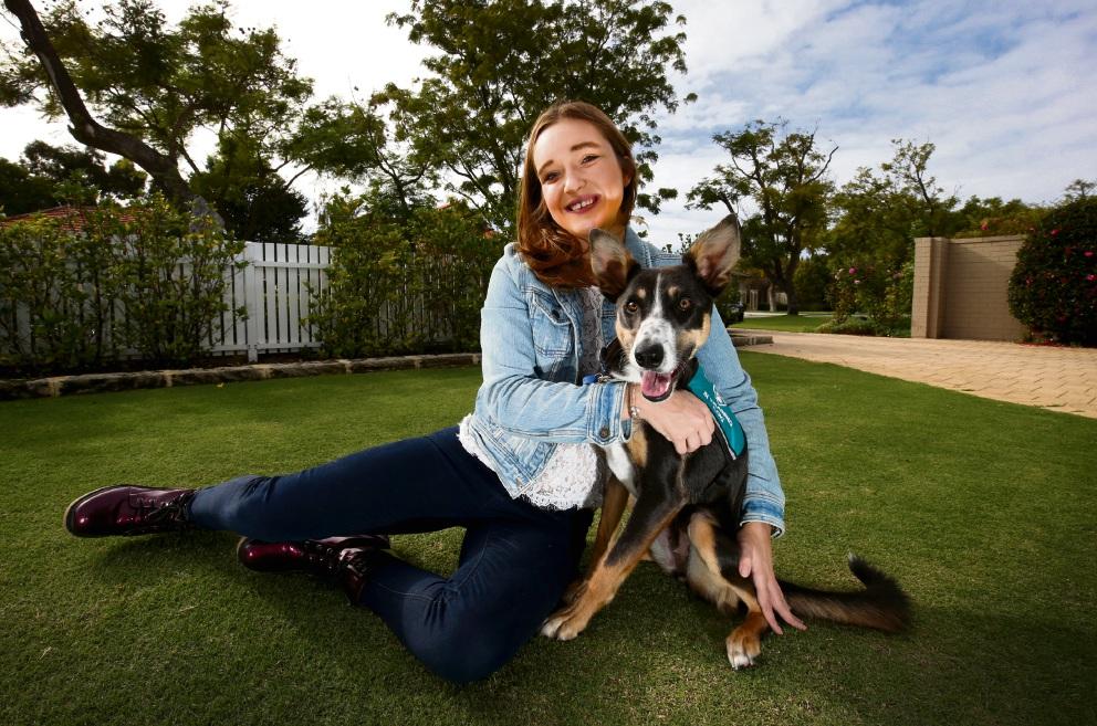 Tara Lord and rescue dog Loki. Picture: Matt Jelonek www.communitypix.com.au d468956