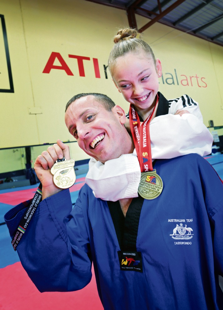 Ashley Ratten of Dianella with his daughter Sonya Peric-Ratten (11). Ashley recently won a World Championship Gold medal and Sonya recently won an Australian National Championships Gold .