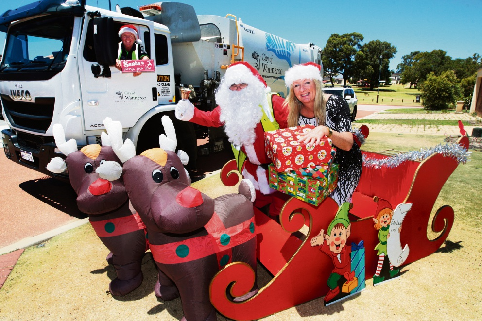 Santa and Wanneroo Mayor Tracey Roberts with Clyde Leach. Picture: Bruce Hunt