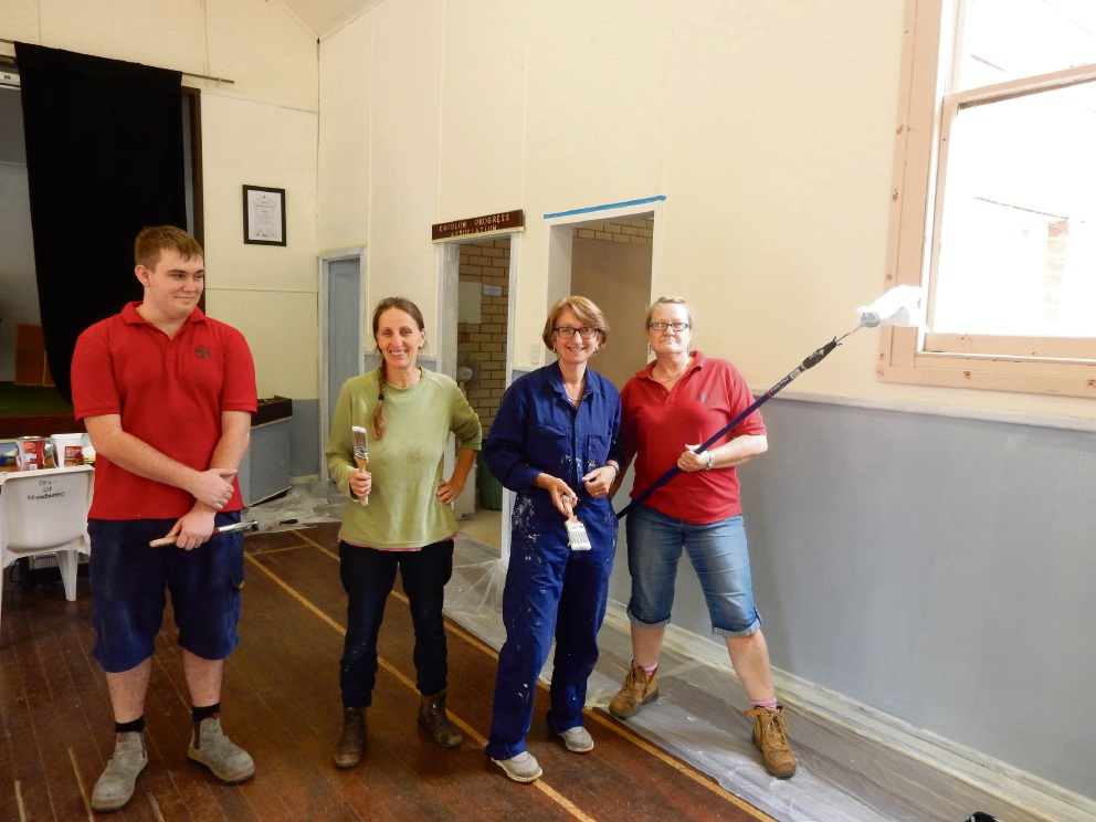 Chidlow Progress Association volunteers give the old hall a fresh coat of paint wit the help of Bunnings team members.