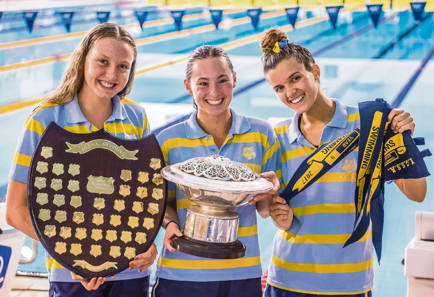 Sophie Fenna, Chloe Jones and Charlotte Salom with the Boans Trophy.