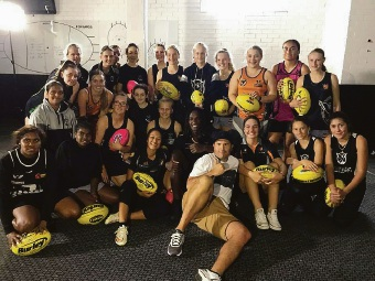 Nic Naitanui with the Swans youth girls' squad. Picture: Facebook