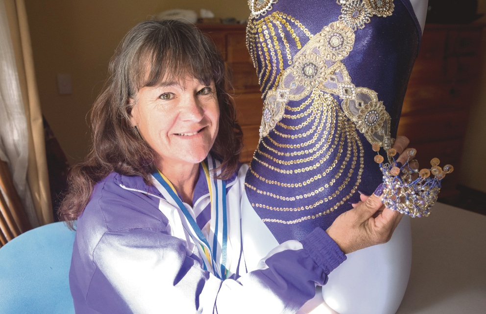 Synchronised swimmer Isla Titley with one of her beaded swim costumes.
