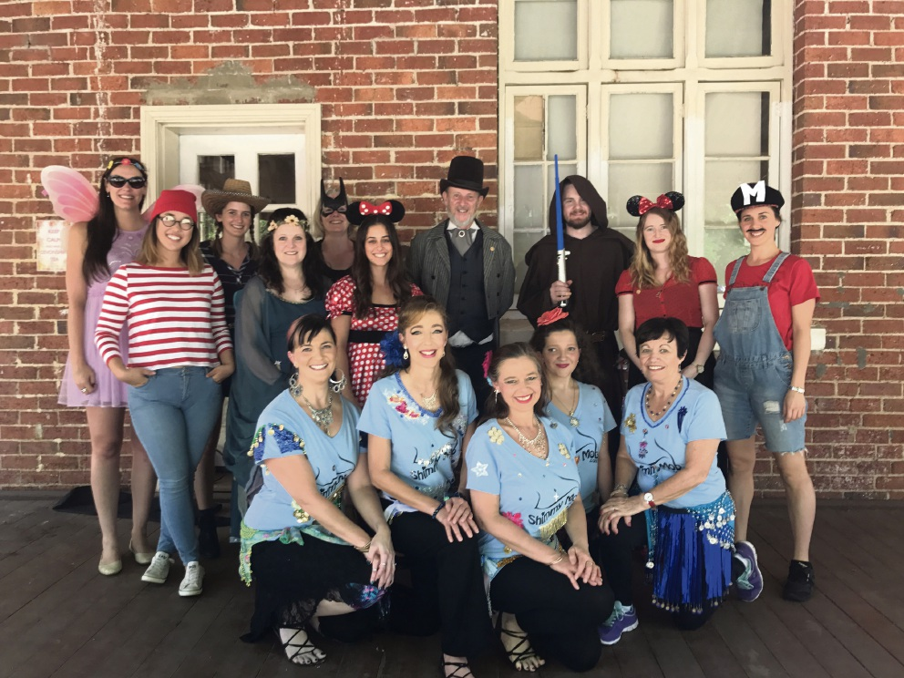 Shimmy Mob dancers from Midland Dance Studio with Parkerville Children and Youth Care CE Basil Hanna (centre back) and staff volunteers, dressed up for their annual picnic.