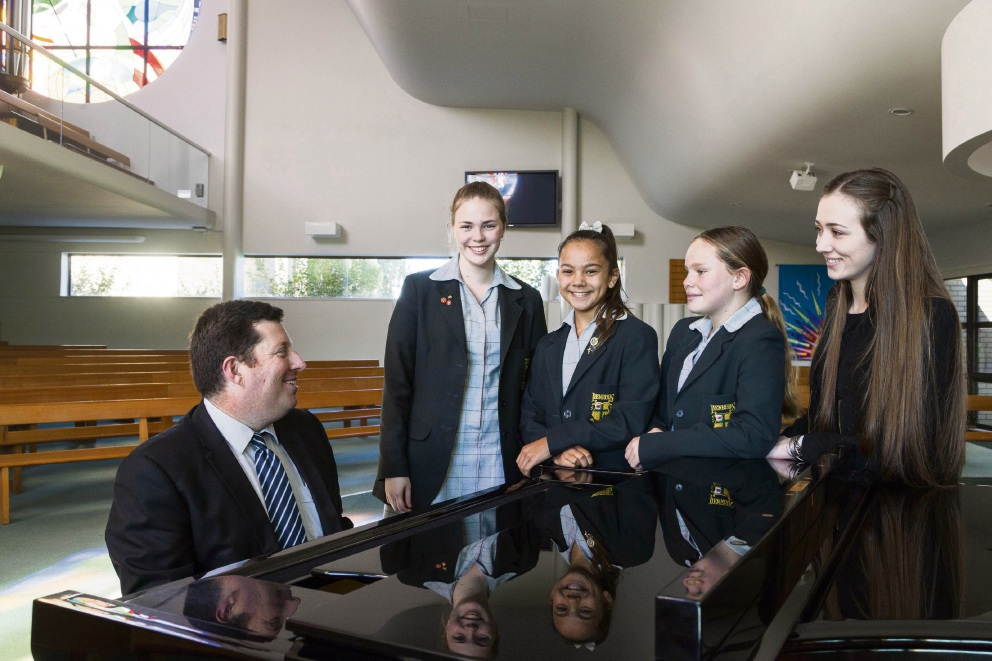Penrhos College Dean of Co-Curricular and former Director of Music Paul McCarthy with Penrhos College chorale students Josie Barrett, Alexandra Cearns and Georgette Kruger, and Secondary Teacher of Music and Choral DirectorCatherine Clarnette.