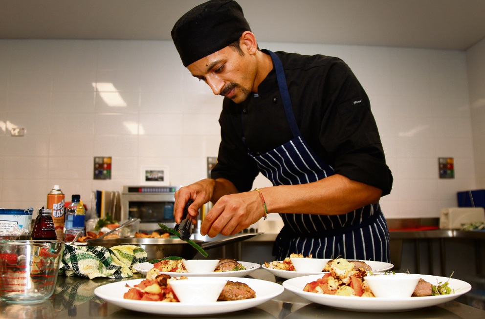 Chef Sumit Kumar busy plating up. Picture: Marie Nirme  d468921