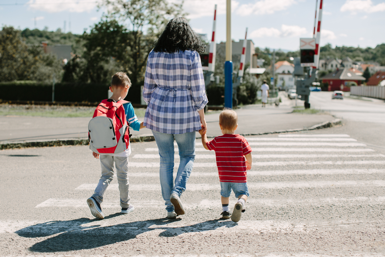 Parents need to hold on to their children while crossing the street