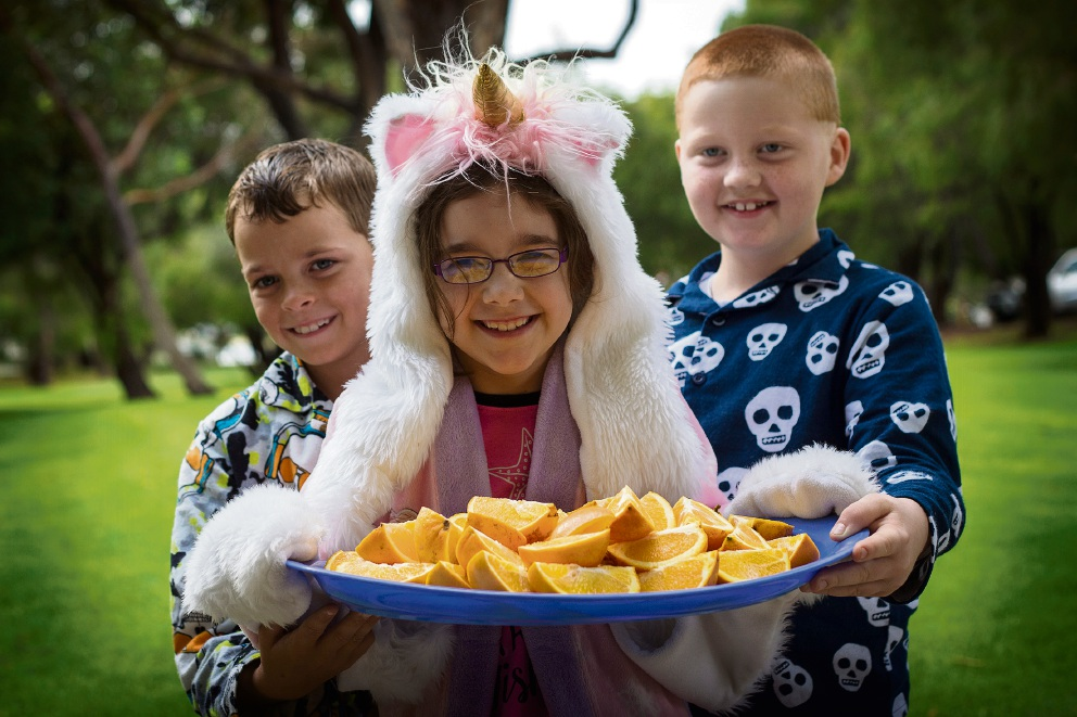 Bryon Smith (8), Marley Wroblewski (8) and Aiden Madden (7) serve up the healthy snacks after their walk. Picture: Will Russell        www.communitypix.com.au   d469249