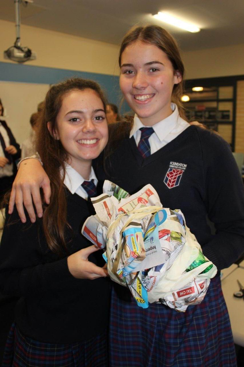 Foundation Christian College Year 9 students Megan Machado and Tia Kennedy Smith with the armour they created.