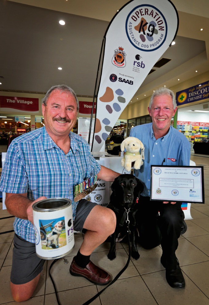 Peter Checkley raising awareness and funds for the program, with IGA High Wycombe's Matt Pham. Picture: David Baylis.