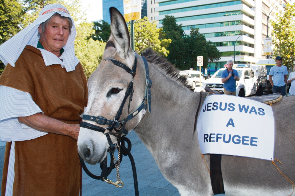 Palm Sunday Walk for Justice for Refugees calls for 'compassion, not punishment'