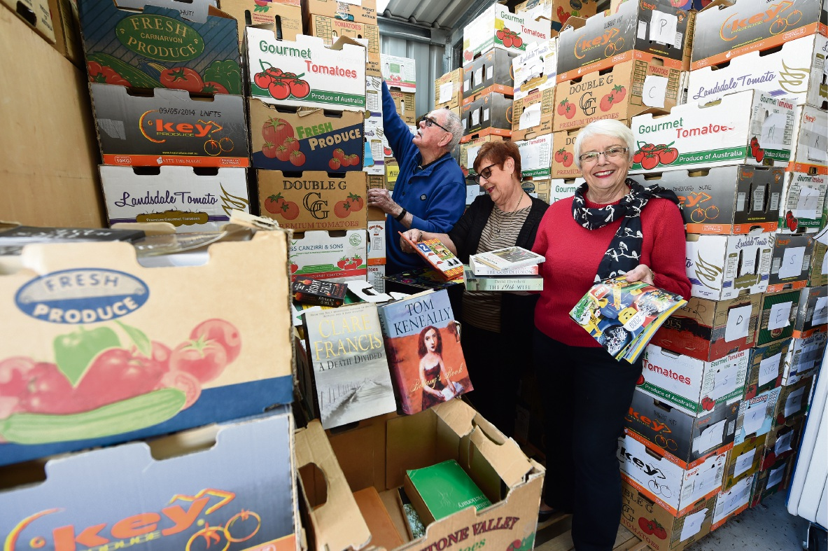 Lyle and Gabrielle Portwine as well as Susan Langton sort through the thousands of books that will be available at the Monster Parish Book Sale next month. Picture: Jon Hewson