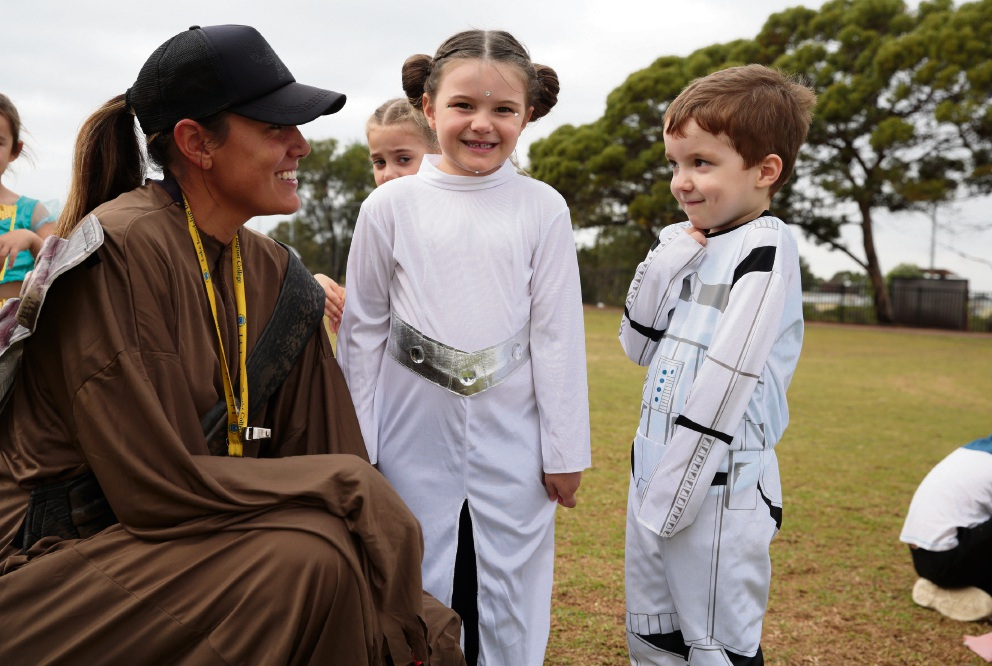 Pre-primary teacher Loren Coulson with Nevaeh Wood and Xaviar Galvin. Below: Alex Malinovic with 'Chewbacca'. Pictures: Martin Kennealey d468878
