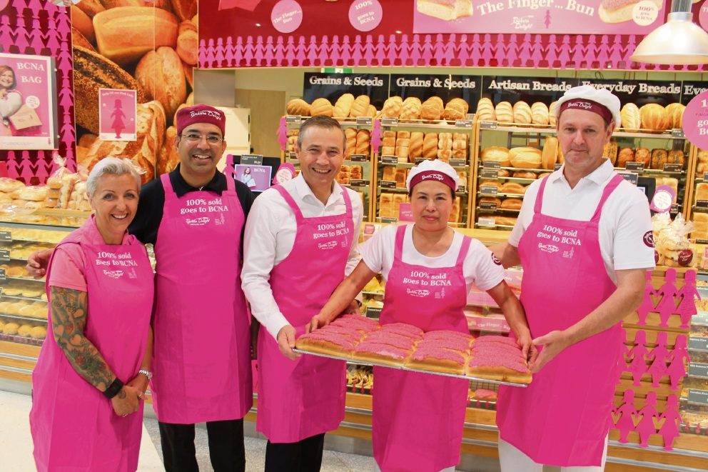 Breast cancer survivor Marie Martin, Baker's Delight state manager Darren Rodricks, Health Minister Roger Cook and franchise owners June and Steve Martin at the Kwinana Baker's Delight store.