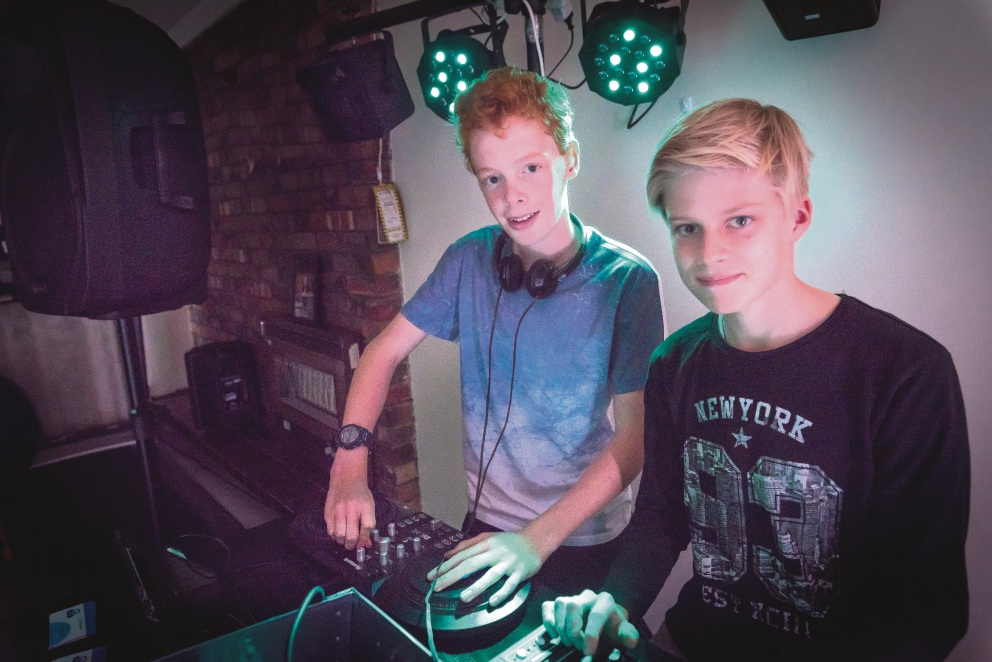 DJs Lachlan and Bryn spinning the decks.