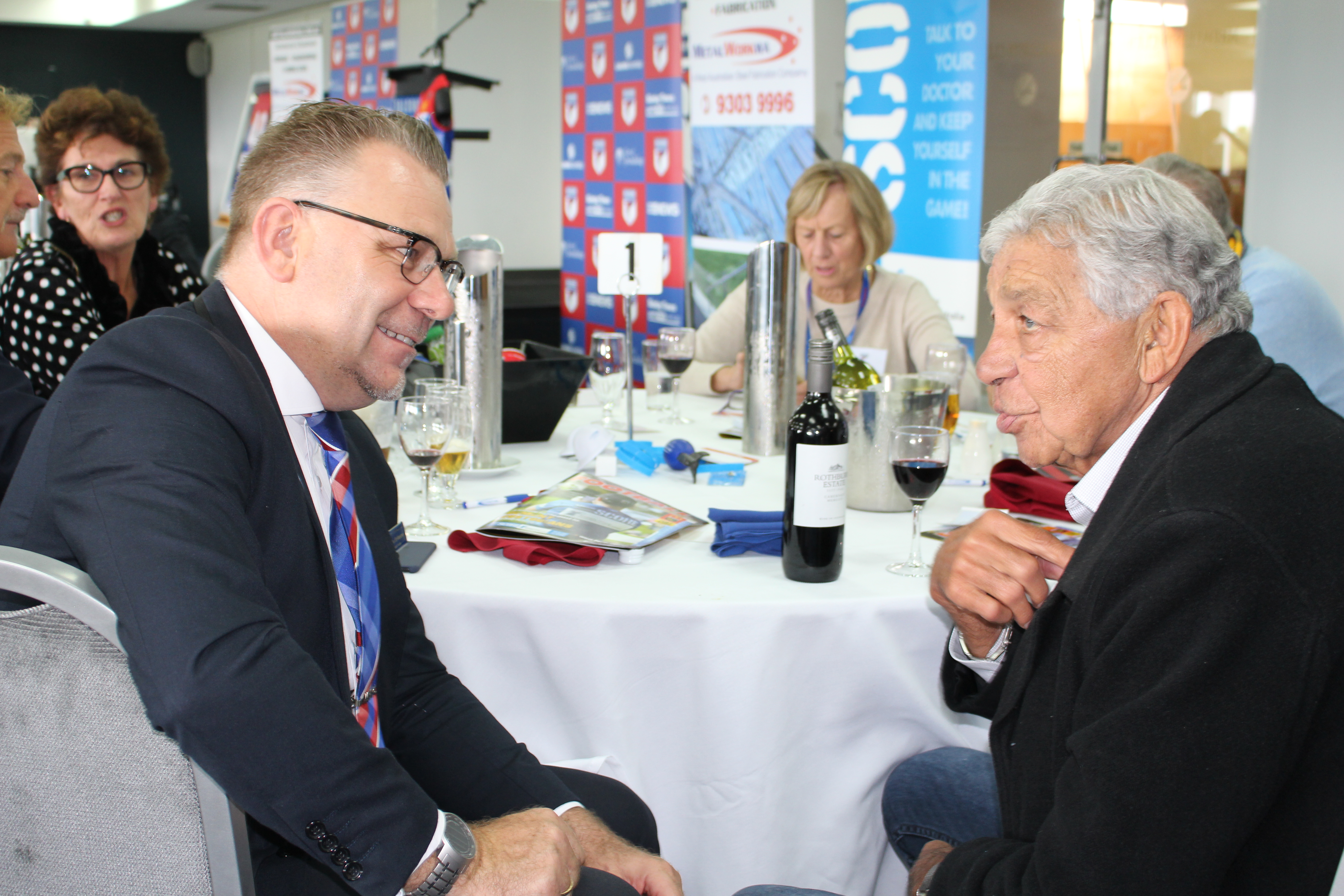 Falcons director Chris Erikson chats to club legend Bill Dempsey.