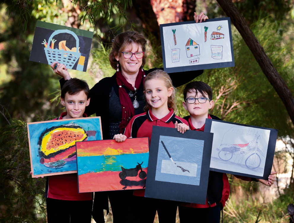 Getting ready: Wooroloo Primary School students Jack Burns (10), Kaylee Gale (9) and Riley Pettit (8), with art specialist Christine Morton. Picture: David Baylis    d468420