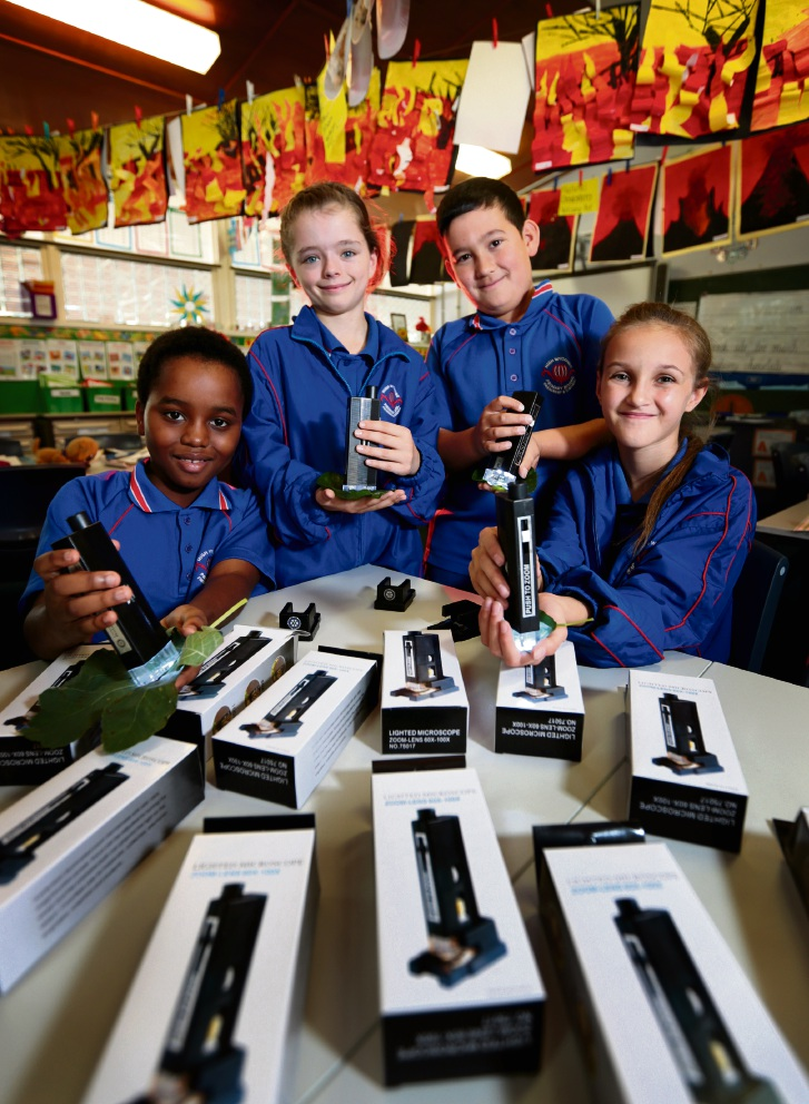 High Wycombe PS students Clive Aubyn (9), Sarah Spratt (9), Will Whisler (9) and Sinead Slater (10). 30 microscopes have been donated to High Wycombe Primary School by Kalamunda Rotary. Picture: David Baylis d469386a