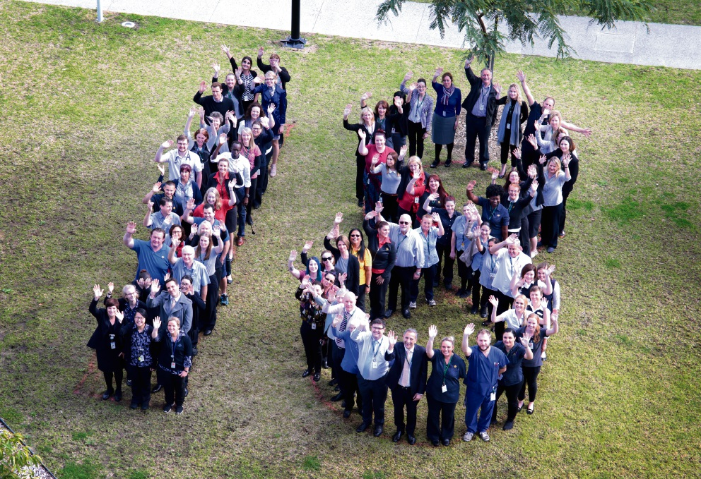 Staff at St John of God Midland Public Hospital form the number 18 to celebrate the hospital's 18-month anniversary. Picture: David Baylis d469526