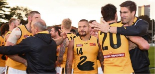 Leroy Jetta celebrates with his team mates after WA defeated Victoria.
