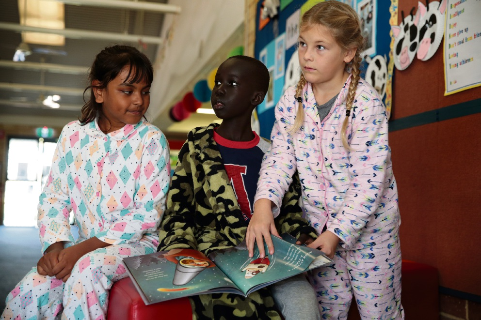 Riana Debnath, Samuel Deng and Marlee Hatton from Merriwa PS took part in National Simultaneous Storytime. Picture: Martin Kennealey