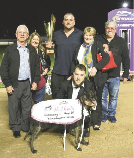 Cosi Dagostino (centre) holds the trophy won by greyhound Lini Danco at the WA Oaks last weekend.
