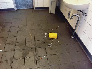 Syringes and a disposal container were left on the floor of the disabled toilets at Cockburn Station in early February. Picture: Facebook