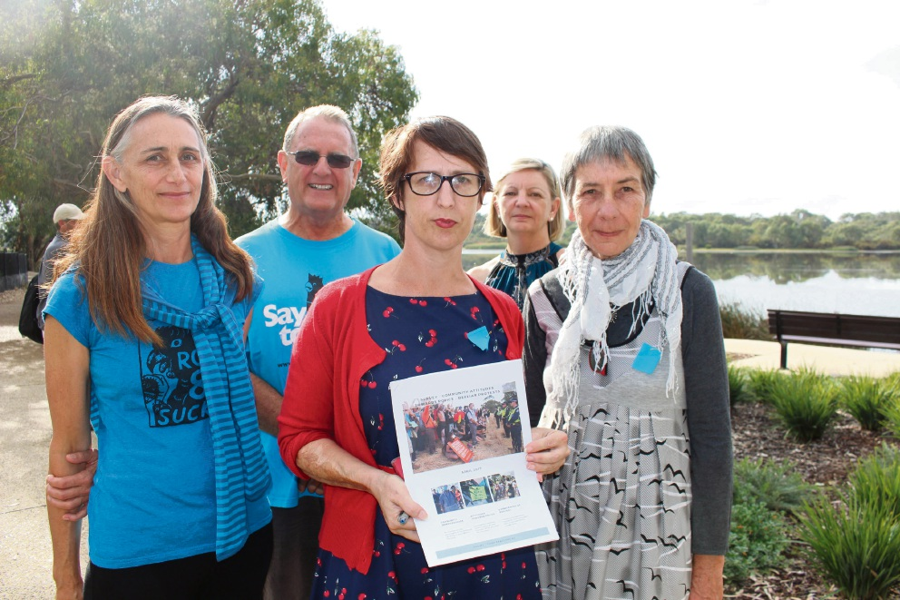 Ilona McGavock, Mal Christison, Beeliar Legal Support spokeswoman Nicola Paris, Kim Dravnieks and Christine Duckham with the report into the policing of Roe 8 protesters.