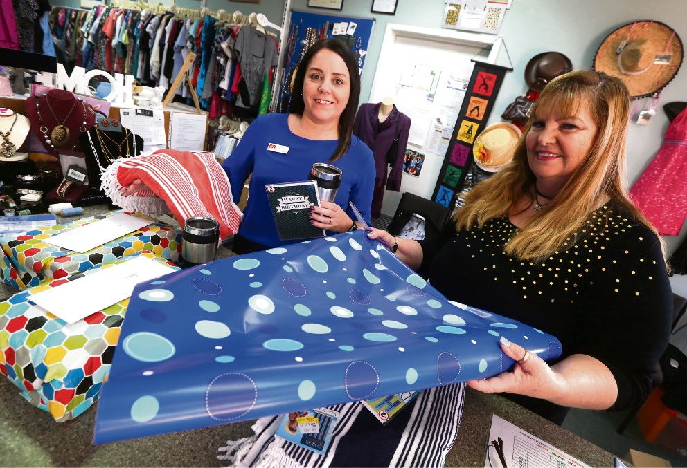 HD Streetwise founder Shelley Hubon wrapping presents with P&N Bank's Joy Evans.