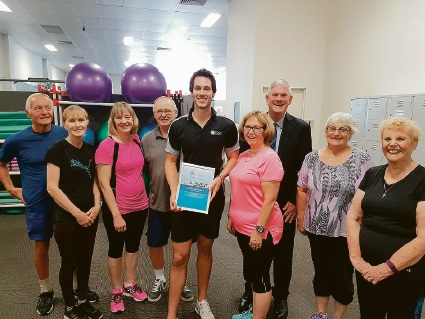 Award-winner Transitions Health and Fitness' Tyler Hall with Living Longer Living Stronger participants and Cockburn Mayor Logan Howlett.