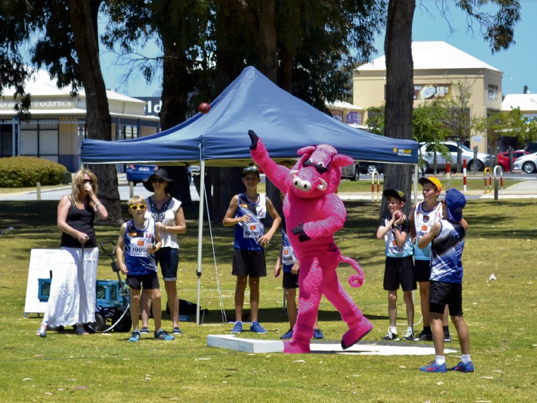 Mascots race for the finish line with some young athletes during the opening day of the summer season.