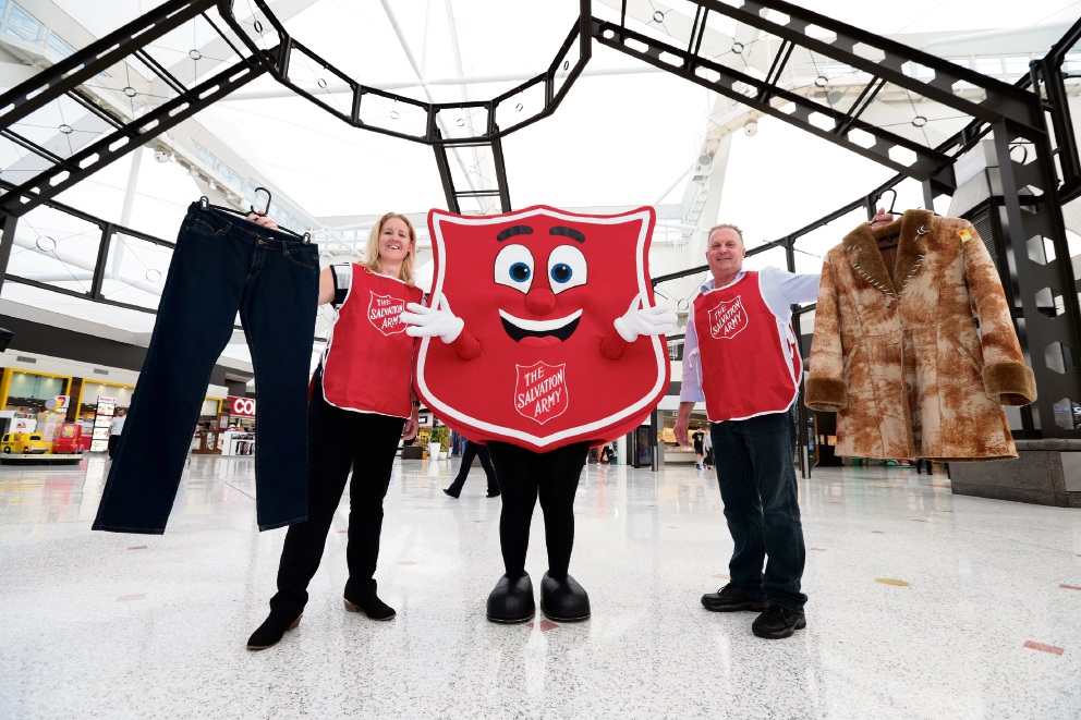 Salvation Army staff Ash Greenwood and Nigel Pitkin with mascot Sally Shield. Picture: Martin Kennealey        d469905