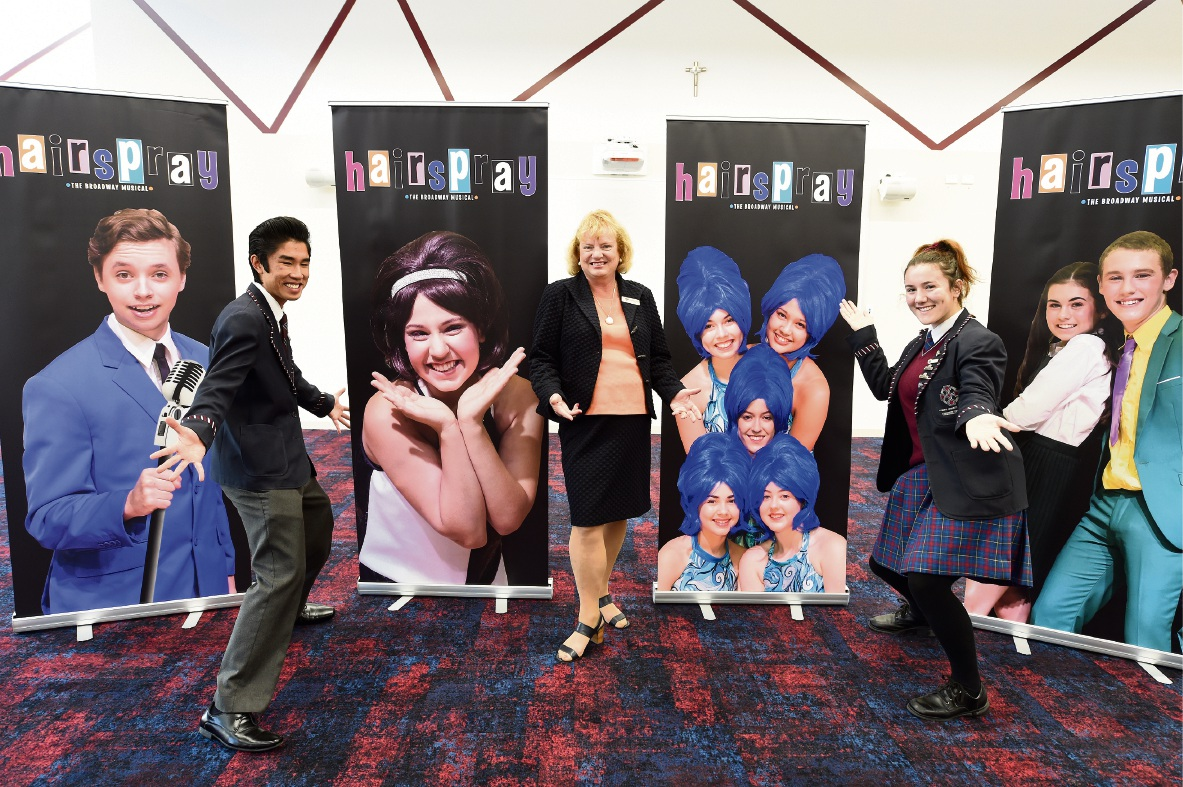 Corpus Christi College arts captains Peter Ho and Nadia Long with principal Caroline Payne at the school's new performing arts centre.