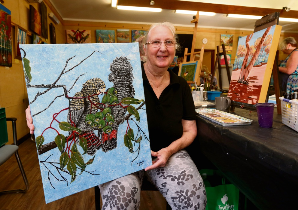 Marilyn Savil, of Forrestfield, with her artwork for the exhibitionwhich features endangered wildlife.