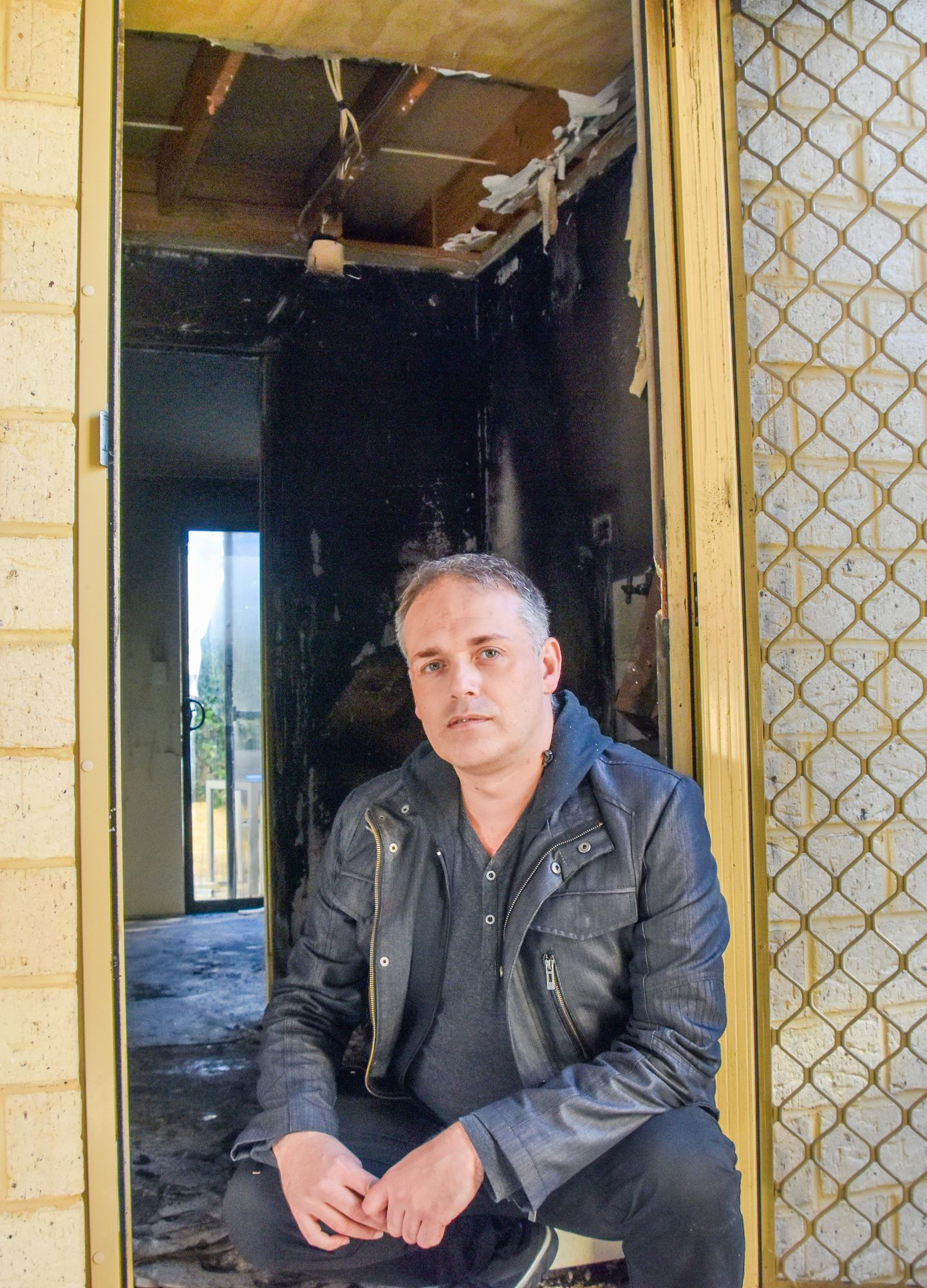 Andrew Wilkinson in his destroyed Nollamara home. Picture: DFES